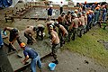 US Navy 060726-N-0553R-002 Philippine Navy Seabees and U.S. Navy Seabees assigned to Naval Mobile Construction Battalion One (NMCB-1) form a bucket brigade to transfer concrete.jpg