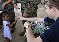 US Navy 070224-N-8487G.098 Hospitalman Nathan Horning, assigned aboard the amphibious transport dock USS Juneau (LPD 10), gives out toys to a young child during a Medical Civic Action Project (MEDCAP).jpg