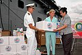 US Navy 070618-N-6410J-048 Pacific Partnership Mission Commander, Capt. Bruce Stewart and the Honorable Kristie A. Kenney, United States Ambassador to the Philippines, turns over a box from Project Handclasp to the Honorable Es.jpg