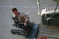 US Navy 070812-N-6794Z-001 Explosive Ordnance Disposal Technician 1st Class Brian Franke, attached to Explosive Ordnance Disposal Mobile Unit (EODMU) 11, Company 3-15, lifts a robot from the trunk of a humvee in preparation for.jpg