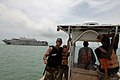 US Navy 070830-N-0989H-416 Gunner's Mate 2nd Class Jacob Lambuth explains boat maneuvers to members of the Belize Coast Guard during patrol craft operations training, one of the many courses that are part of the pilot Glo.jpg