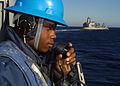 US Navy 070910-N-3925A-003 Seaman Jason Nixon, assigned to deck department aboard amphibious transport dock USS Cleveland (LPD 7), uses a sound-powered phone during preparations for an underway replenishment.jpg