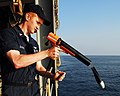 US Navy 080109-N-8933S-044 Aerographer's Mate 3rd Class Brandon Davis launches a Sippican MK-2 bathythermograph data acquisition system.jpg