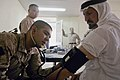 US Navy 080723-M-0252M-015 Hospital Corpsman 2nd Class Reyes Camacho, assigned to Marine Wing Support Squadron (MWSS) 172, checks the blood pressure of an Iraqi patient in the triage area of a clinic at Akashat.jpg