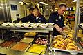 US Navy 081127-N-5758H-639 Mineman 1st Class Jose Avelar and Senior Chief Operations Specialist Thomas Dunning make their Thanksgiving dinner plates.jpg