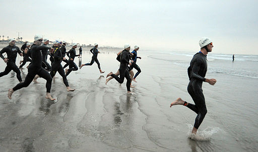 US Navy 090329-N-2959L-169 Athletes race to the water to begin the swim portion of the 31st annual Superfrog Triathlon at Silver Strand State Beach