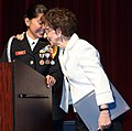 US Navy 090610-N-3135G-982 Navy Junior ROTC Cadet Cmdr. Jaqueline Duarte, valedictorian for the first graduating class from Hyman G. Rickover Naval Academy, is embraced by Eleanore Rickover, widow of Adm. Hyman G. Rickover.jpg