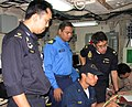 US Navy 090818-N-7058E-047 Republic of Singapore Navy Maj. Ooi Loong, Royal Malaysian Navy Lt. Hisham and Republic of Singapore Navy Capt. K.C. Teo observe U.S. Navy Ensign Duran Cheek.jpg