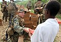 US Navy 100126-M-8605C-002 A Marine assigned to the Battalion Landing Team, 3rd Battalion, 2nd Marine regiment, distributes humanitarian rations at an aid station near a landing zone in Leogane, Haiti.jpg