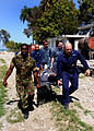 US Navy 100129-N-6676S-007 Sailors carry an injured Haitian woman to the landing zone at the Killick Haitian Coast Guard Base to be airlifted to a nearby treatment facility.jpg