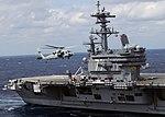 US Navy 100303-N-3885H-172 An MH-60S Sea Hawk helicopter flies alongside USS George H.W. Bush (CVN 77).jpg