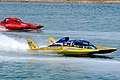 US Navy 100502-N-8020M-021 Retired Navy Cmdr. Paul Becker takes the lead in the UL-14 Go Navy hydroplane during the 2010 Lucas Oil Firebird Spring Nationals Drag Boat Races at Firebird Raceway.jpg