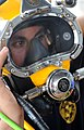 US Navy 100522-N-0413B-147 Navy Diver 2nd Class Jessie Trujillo, assigned to Mobile Diving and Salvage Unit (MDSU) 1, conducts voice checks in a MK-3 dive helmet.jpg