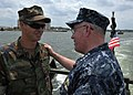 US Navy 100719-N-9095H-029 Adm. J.C. Harvey Jr., commander of U.S. Fleet Forces Command, speaks with Gunner's Mate 2nd Class Michael Finch, left, assigned to Riverine Squadron (RIVRON) 1,.jpg