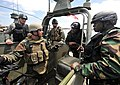 US Navy 110520-N-YO394-149 A Sailor from Riverine Squadron (RIVRON) 1 exchanges ideas for operations on a Riverine combat boat with officers from.jpg