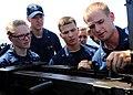 US Navy 110606-N-BZ392-455 Gunner's Mate 3rd Class Justin Pruett, right, instructs Navy ROTC midshipmen on gun safety before a .50-caliber machine.jpg