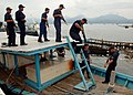 US Navy 110701-N-NJ145-300 Philippine navy sailors board a fishing vessel during a tactical boarding training exercise with U.S. Coast Guard Mariti.jpg