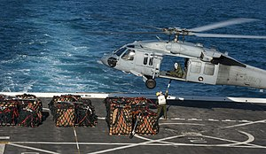 US Navy 120129-N-PB383-600 Marines attach cargo to an MH-60S Sea Hawk helicopter embarked aboard the Military Sealift Command dry cargo and ammunit.jpg