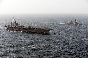 US Navy 120213-N-DR144-921 The Arleigh Burke-class guided-missile destroyer USS Momsen (DDG 92) pulls alongside the Nimitz-class aircraft carrier U.jpg