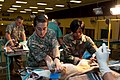 US and South African Army Vet Technicians Prepare Dog for Spaying.jpg