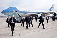 United States President Barack Obama with Senator Sherrod Brown, Representative Mary Jo Kilroy, and Secret Service personnel arriving at Port Columbus International Airport.jpg