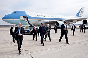 United States President Barack Obama with Senator Sherrod Brown, Representative Mary Jo Kilroy, and Secret Service personnel arriving at Port Columbus International Airport.jpg