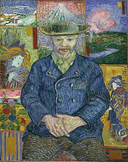 Portrait of a man of a bearded man facing forwards, holding his own hands in his lap; wearing a hat, blue coat, beige collared shirt and brown pants; sitting in front of a background with various tiles of far eastern and nature themed art.