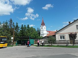 The main square of Varbó with a local church and bus stop