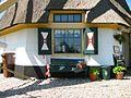 Veldmuur met raam en luiken van achtkante grondzeiler - AMR Molenfoto - 20541717 - RCE.jpg
