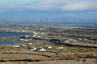 Aran Islands - A view over Inishmore, from Dún Eochla, with Inishmaan and Cliffs of Moher in the background.