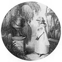 A young girl standing in front of an urn and surrounded by ferns.