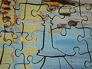 """A """"whimsy"""" piece in a wooden jigsaw puzzle"""