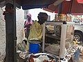 Woman selling cooked food at the market.jpg