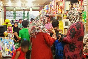 Islam and clothing - Hijab-wearing Bangladeshi women shopping at a department store in Comilla, Bangladesh.