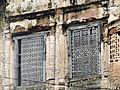 Wood work art style,windows of Mahlog palace, under Simla Hill States ,Himachal Pradesh,India.jpg