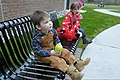 Young children sit on a bench outside the new Marysville Armed Forces Reserve Center in Marysville, Wash., April 1, 2012 120401-A-RB545-109.jpg
