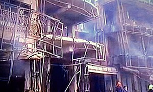 2016 Karrada bombing - Immediate aftermath of the bombing, with smoke spewing from inside the building