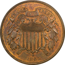A bronze coin with a shield in the center, dated 1865.
