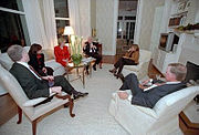 """The Library at Number One Observatory Circle. Vice President Dick Cheney and Lynne Cheney entertain his then Chief of Staff for the Vice President Lewis """"Scooter"""" Libby (left) and his wife Harriet Grant (second on right) and former Vice President Dan Quayle (right) and his wife Marilyn Quayle (second on left) in the first floor library at the Naval Observatory Dec. 4, 2001."""