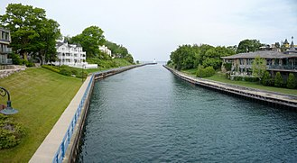 Charlevoix, Michigan - The short Pine River flows through downtown, past the Charlevoix South Pier Light Station, and into Lake Michigan