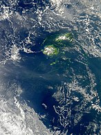Bacterial bloom south of Fiji on October 18, 2010. Though it is impossible to identify the species from space, it is likely that the yellow-green filaments are miles-long colonies of Trichodesmium, a form of cyanobacteria often found in tropical waters.