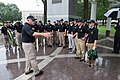 2015 Law Enforcement Explorers Conference explorers stand around with one holding jacket.jpg