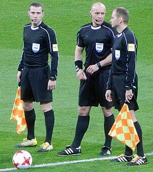 Szymon Marciniak - Marciniak (center) in 2017