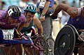 231000 - Athletics wheelchair racing 800m heat Kurt Fearnley action 2 - 3b - 2000 Sydney race photo.jpg