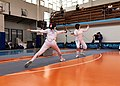 2nd Leonidas Pirgos Fencing Tournament. Advance lunge by Evridiki Koletsou, 6th parry by her opponent.jpg