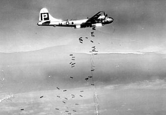 XXI Bomber Command - 39th Bombardment Group B-29 Superfortress dropping 500 pound high-explosive bombs over Japan. Note the high winds in the jet stream scattering the bombs, making precision bombing ineffective from high altitudes.