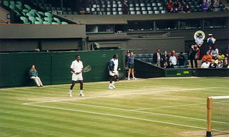 Anand Amritraj - Vijay and Anand Amritraj warm up at 2000 Wimbledon Sr Invitation Doubles Finals in the Centre Court