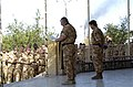 A British Chaplain, 12 Mechanized Brigade, speaks to British Soldiers standing in formation for the St. George's Day ceremony at the Shat Al Arab Hotel in Basrah, Iraq. Saint George - DPLA - f619c25c983ca88b3c92760d46576a14.jpeg