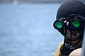 A U.S. Sailor assigned to Coastal Riverine Squadron 1 searches for surface contacts while patrolling San Diego Bay during the squadron's final evaluation problem (FEP) May 21, 2013 130521-N-FN215-491.jpg