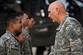A U.S. Soldier assigned to the 4th Squadron, 6th Cavalry Regiment, 16th Combat Aviation Brigade, 2nd Infantry Division shakes hands with Chief of Staff of the Army Gen. Raymond T. Odierno, right, at Camp 140224-A-KH856-915.jpg